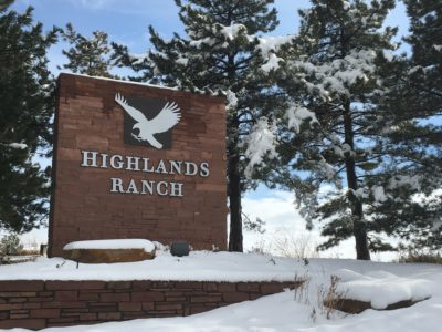 Highlands Ranch city sign covered in snow