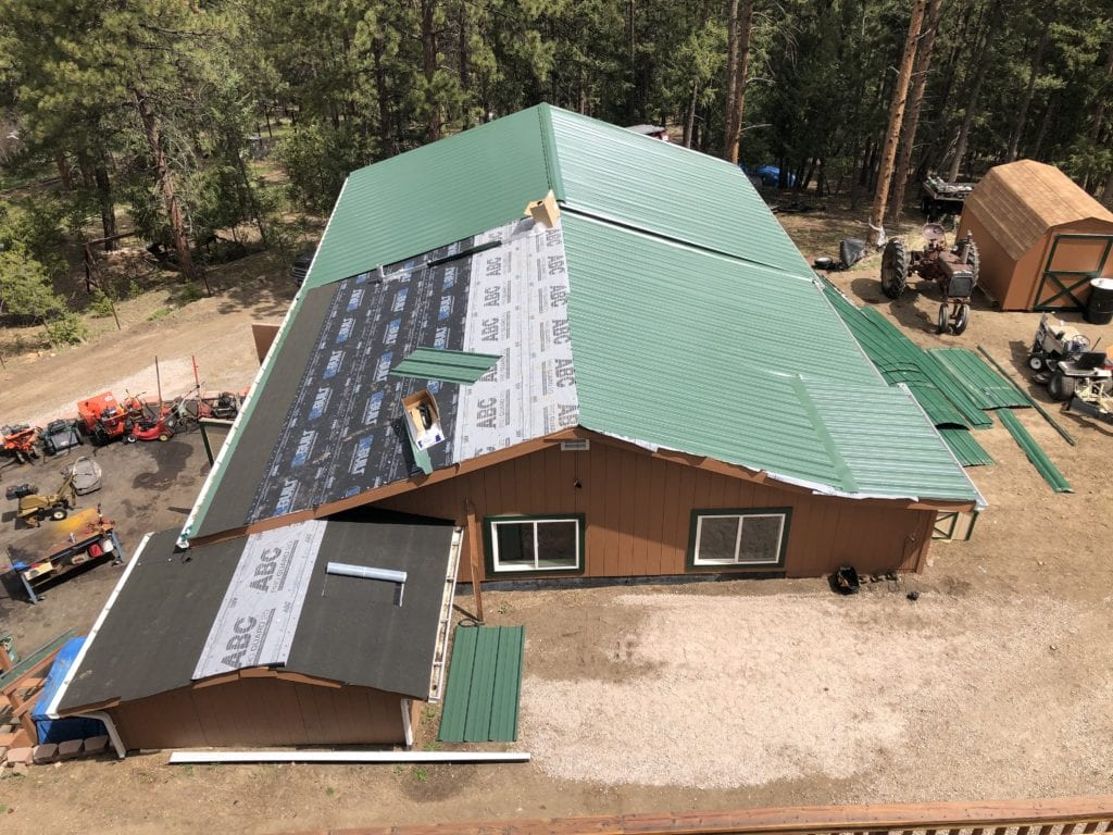 New green metal roofing installation.